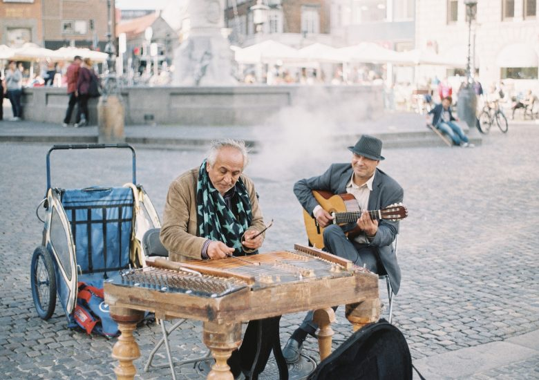 Photo of Two men performing in the street by brandon-hoogenboom on Unsplash