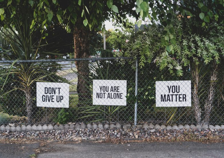 Signs 'Don't Give Up' photographed by Dan Meyers on Unsplash