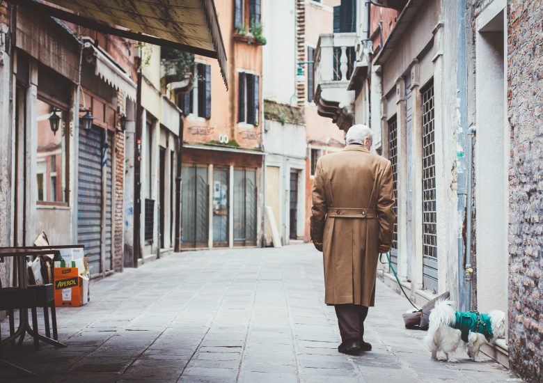 Photo of an old man with a dog by eugene-zhyvchik on Unsplash