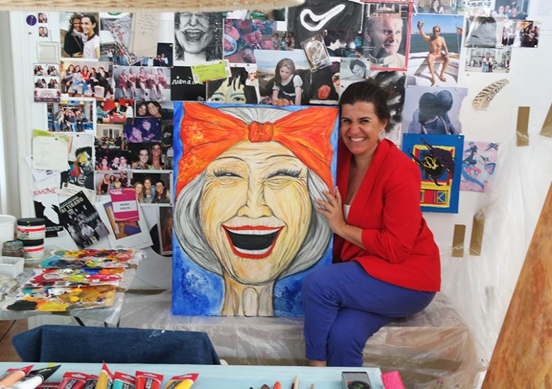 Maria Seruya (artist) with her painted portrait of an older woman